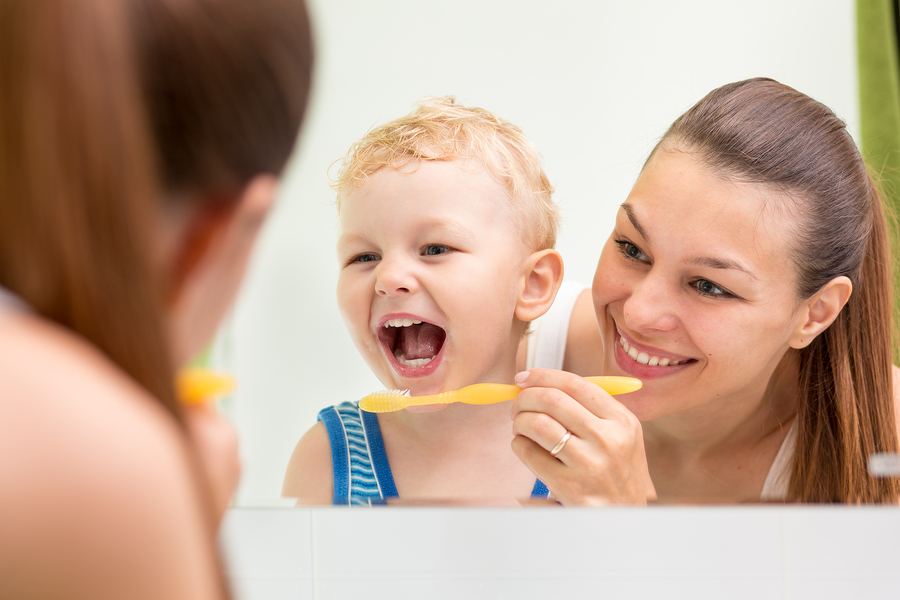 2.1.1 Mother Helping Child Brush in Mirror-Toothbrushing-bullet 3