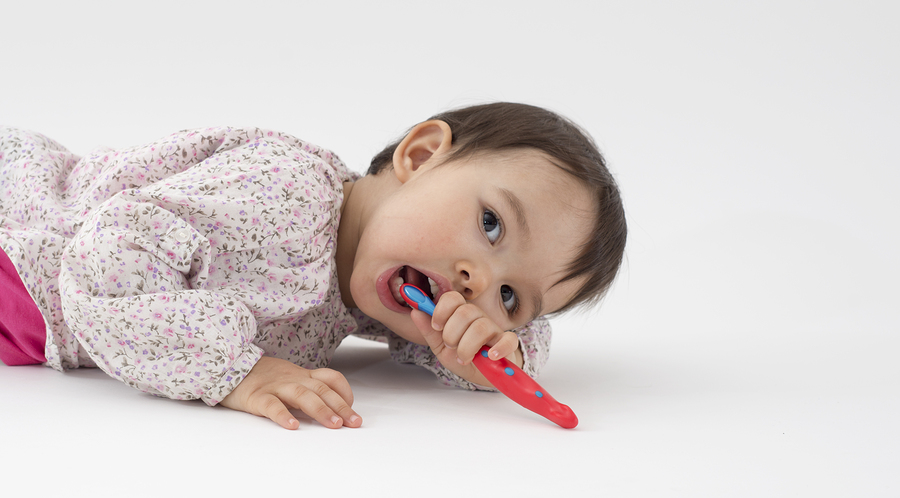 Little Girl With Toothbrush In Her Hand On White Background